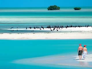 Cuba, uma mistura vibrante de história, música e cultura rodeada pelo mar do Caribe.
